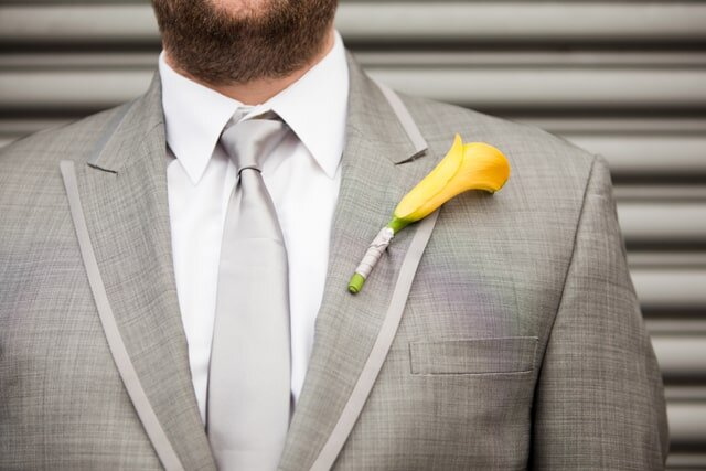 Boutonnière and Gray Grooms Suit image from Arlene Chambers Photography
