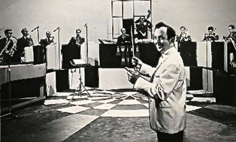 Allan Singleton-Wood pictured with the BBC Welsh Dance Orchestra during rehearsals for the BBC TV series,  Swing High  in 1961. Photograph: Allan Singleton-Wood Collection.
