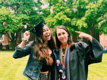 Grace and her roommate, who is in her graduation gown.