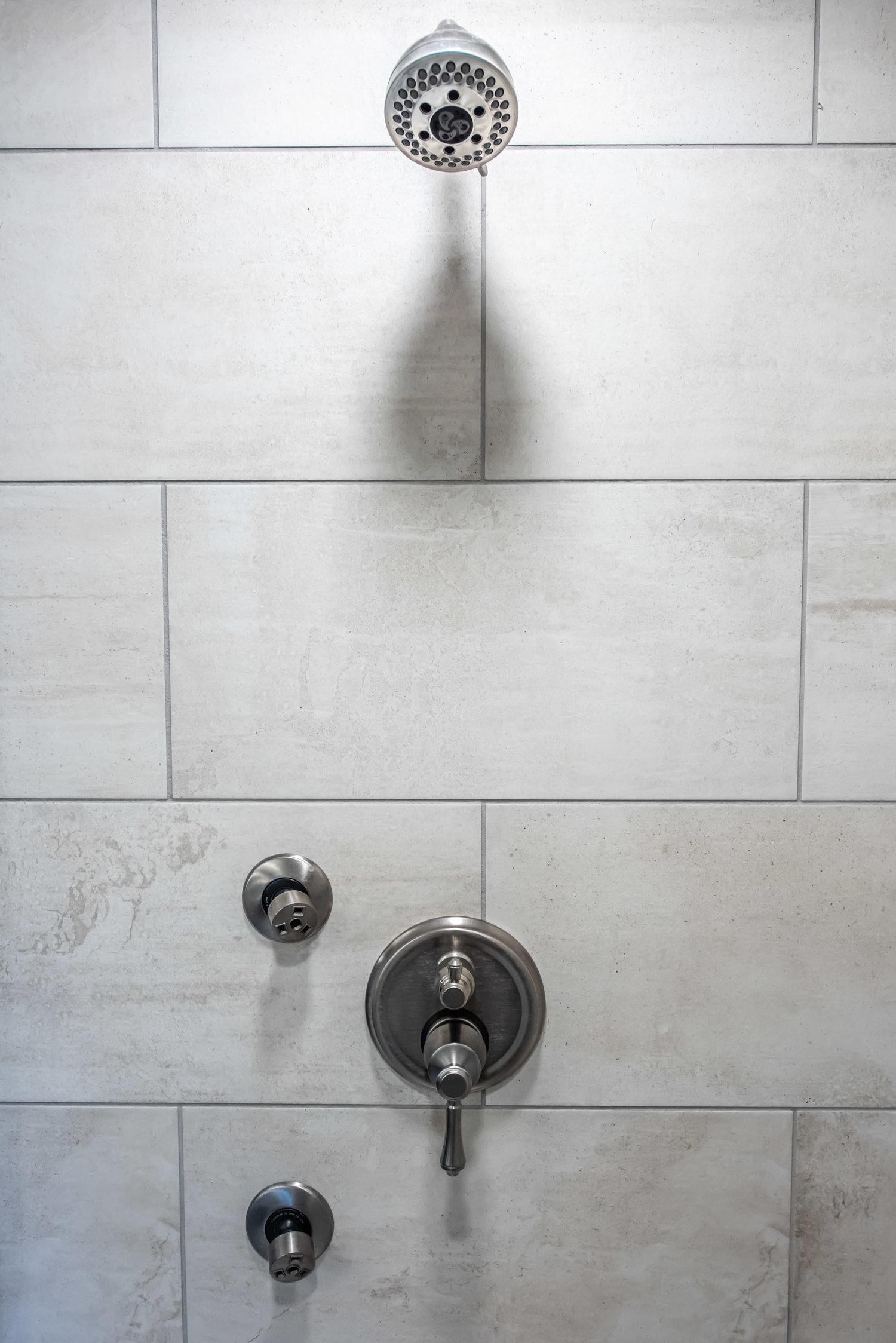 large format tile in a bathroom remodel