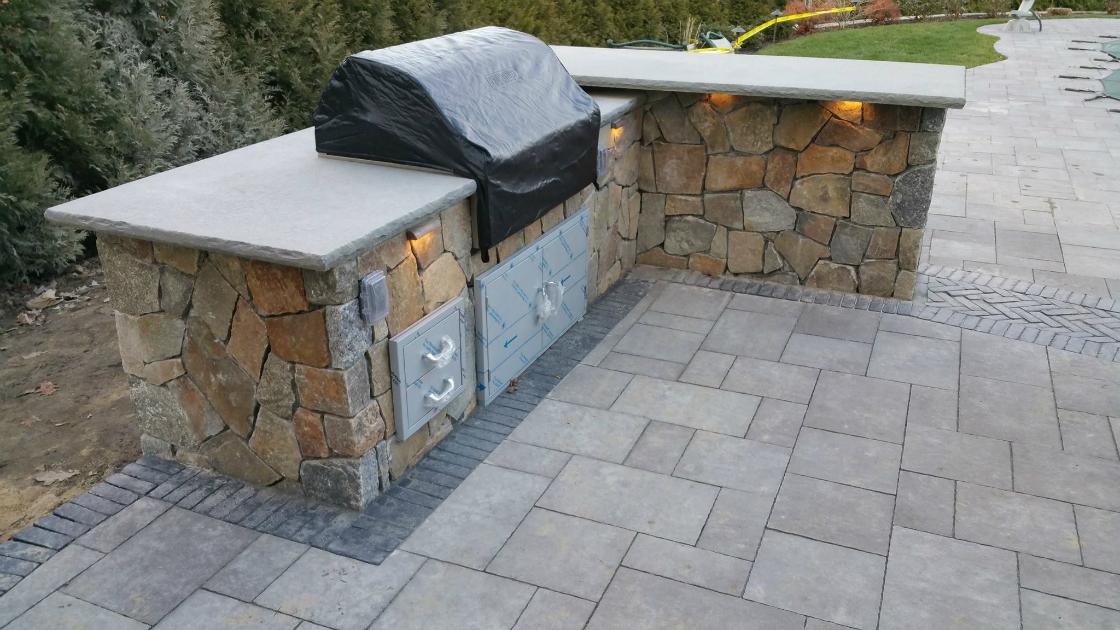 concrete pavers vs natural stone for