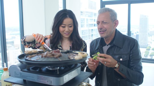 "Episode 105 ""BBQ""  Los Angeles, California - Jeff Goldblum (right) takes part in the viral rend of ""mukbang"", eating Korean BBQ on camera with YouTube sensation, Stephanie Soo. (Photo: National Geographic/Susannah Wilkinson)"
