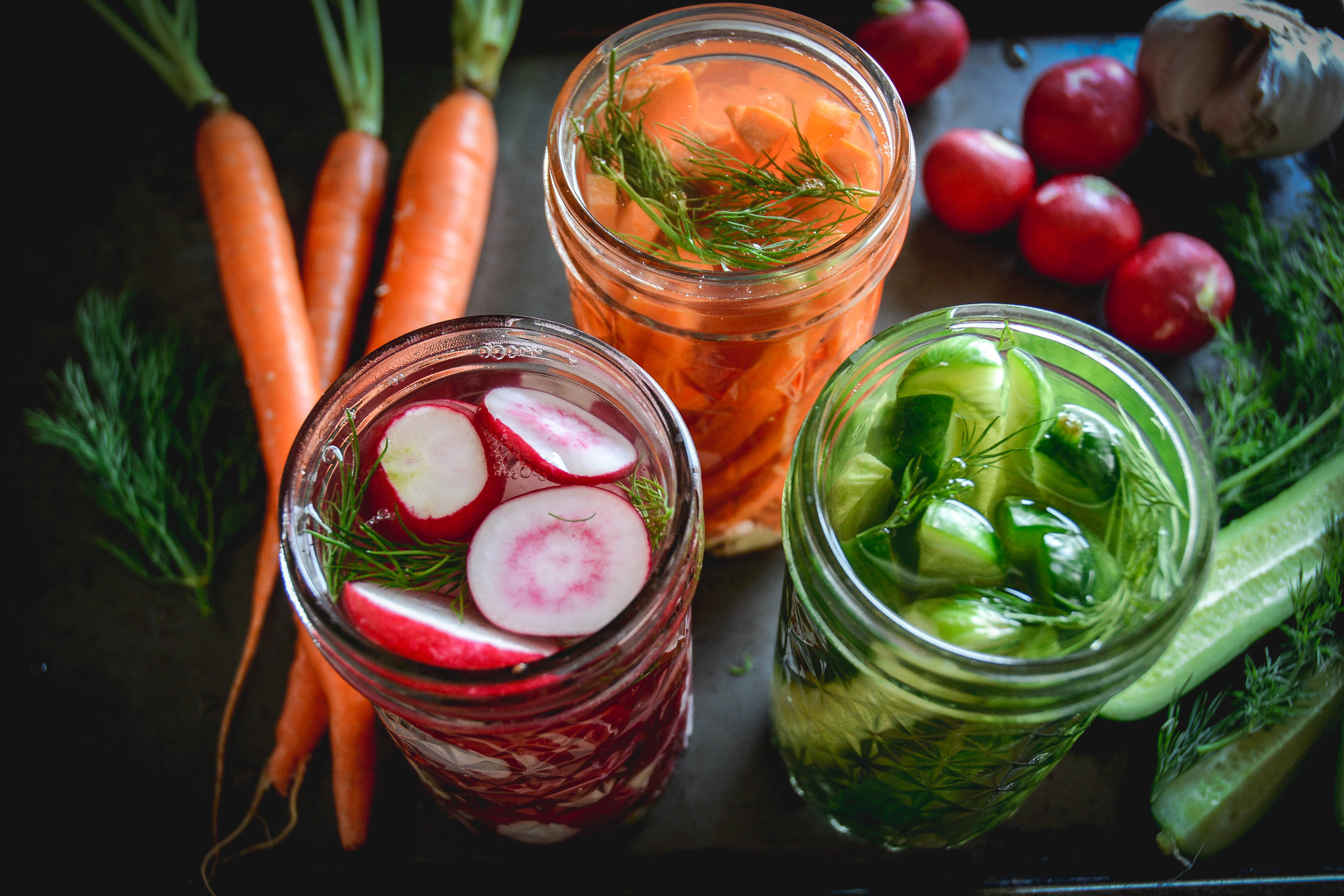 fermented pickles, carrots, and radishes