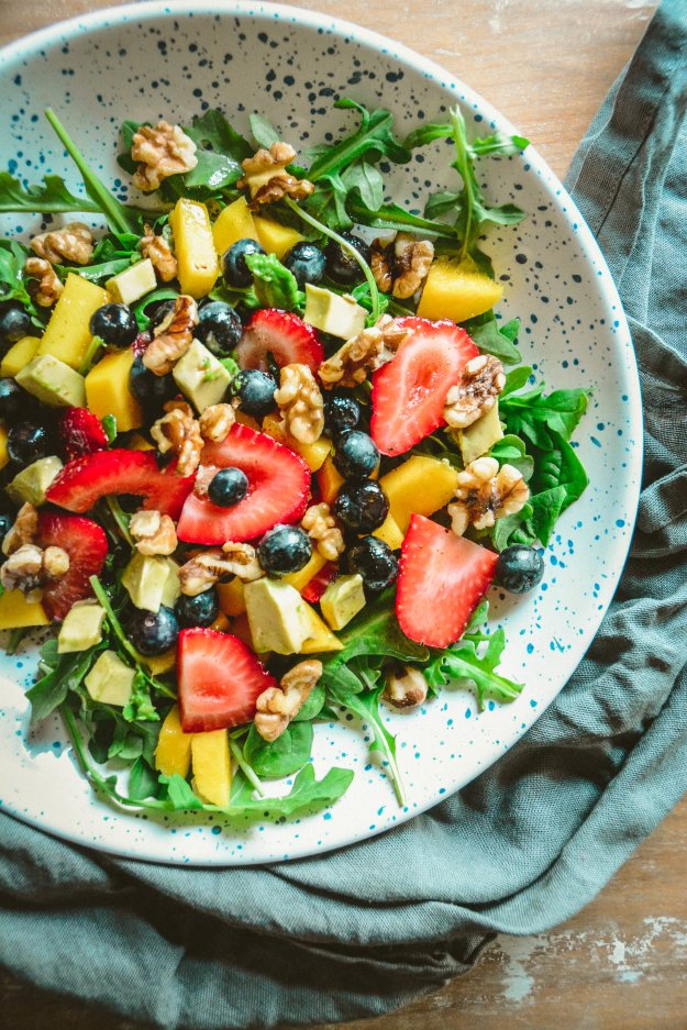 Arugula and Strawberry Salad with Cayenne Lemon Vinaigrette on plate with napkin