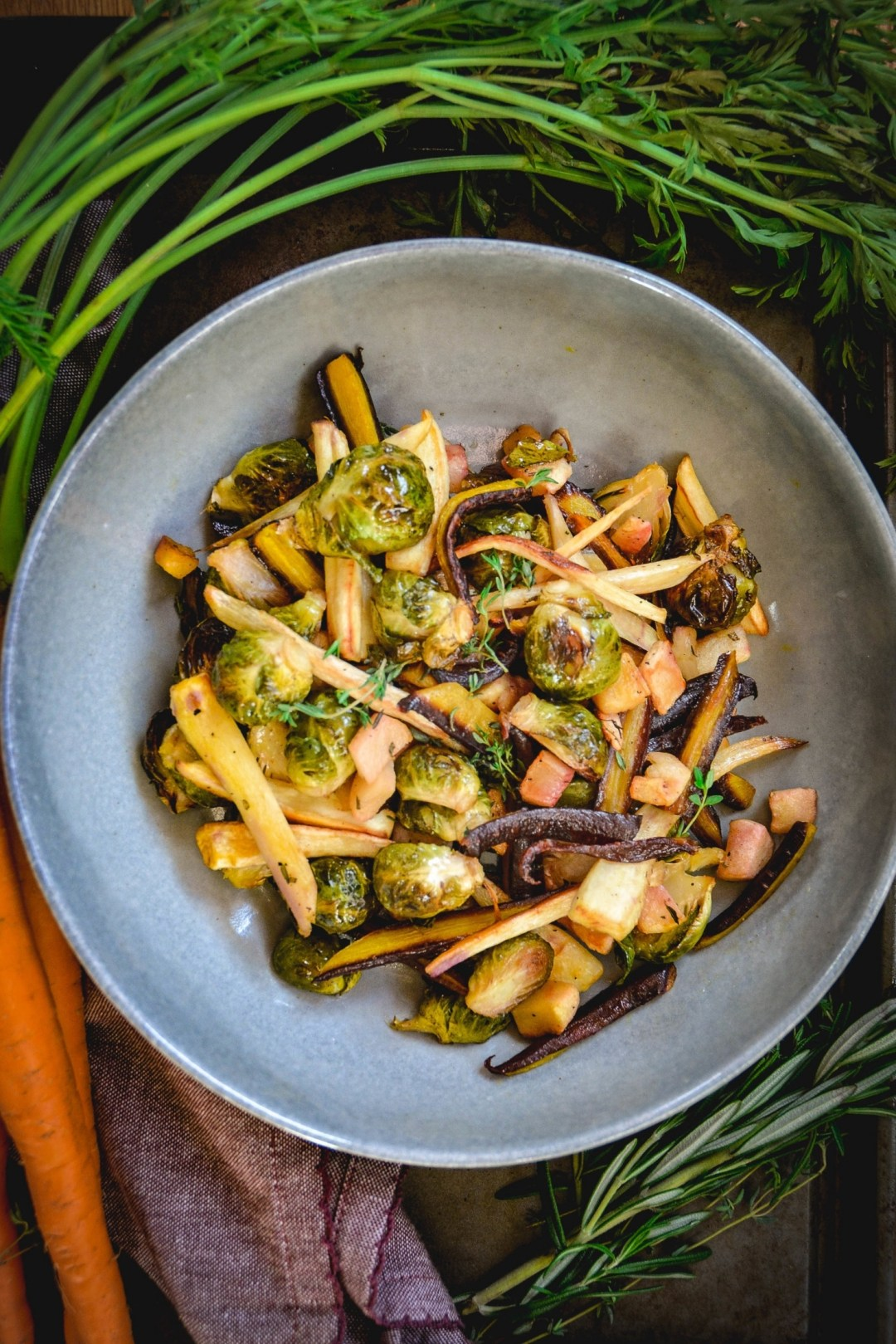 Root vegetables on grey bowl