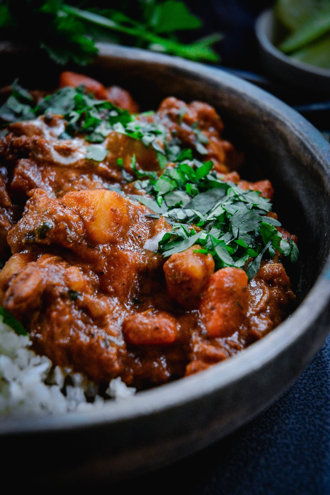 How to make a classic chicken tikka masala dish, paleo and whole 30? Coconut milk, of course. Check out this delicious and hearty recipe that's full of vegetables and tender chicken. It's warming, comforting and loaded with anti-inflammatory spices. #paleofood #curry #paleocurry #paleochickencurry #chickentikkamasala #calmeats #whole30curry #dinner #chicken #whole30recipes #paleorecipes #howtomakecurry #easycurry #chikenrecipes