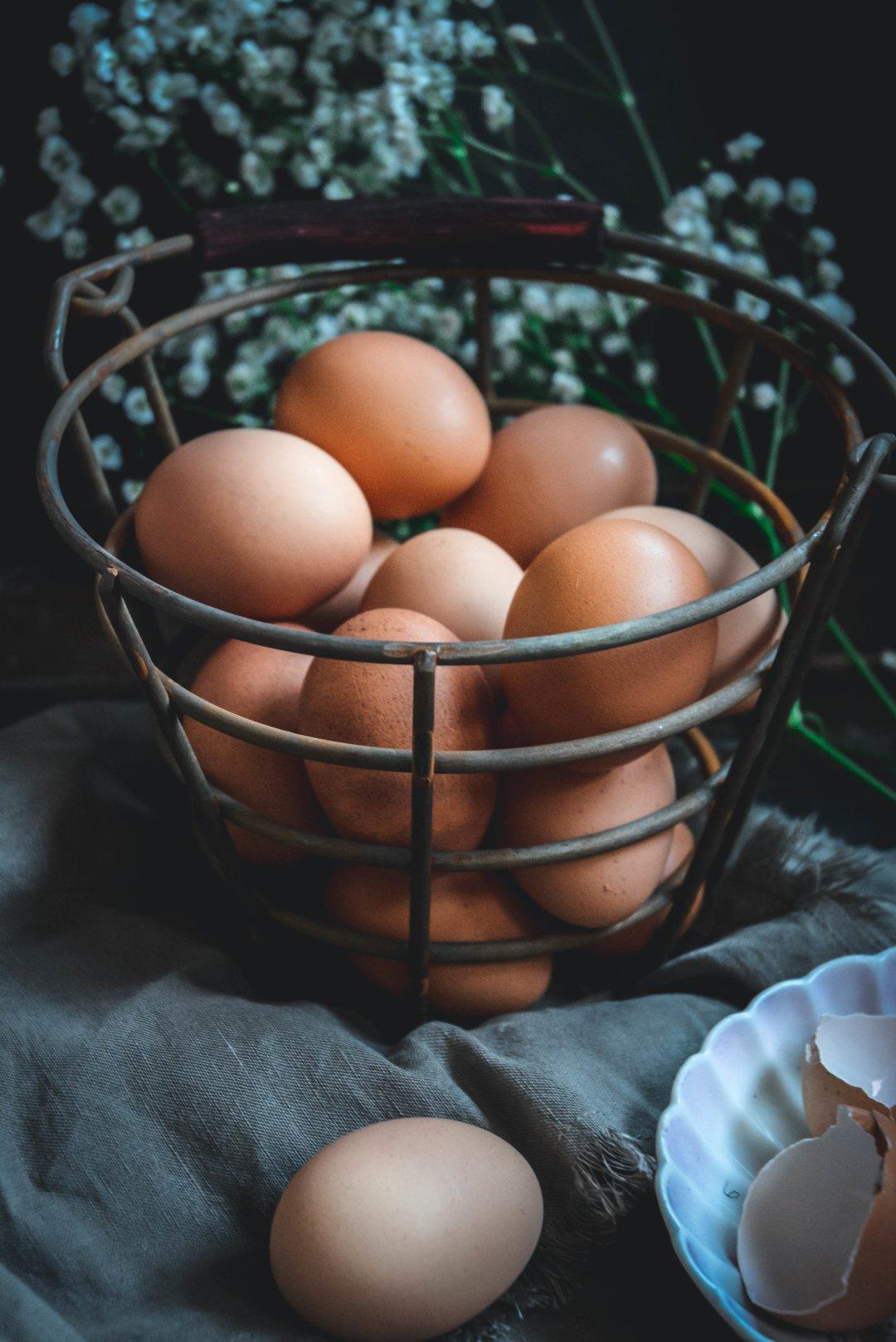 Eggs in basket on napkin