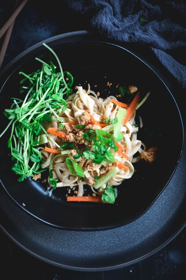 Rutabaga noodles in bowl with carrots and scallions
