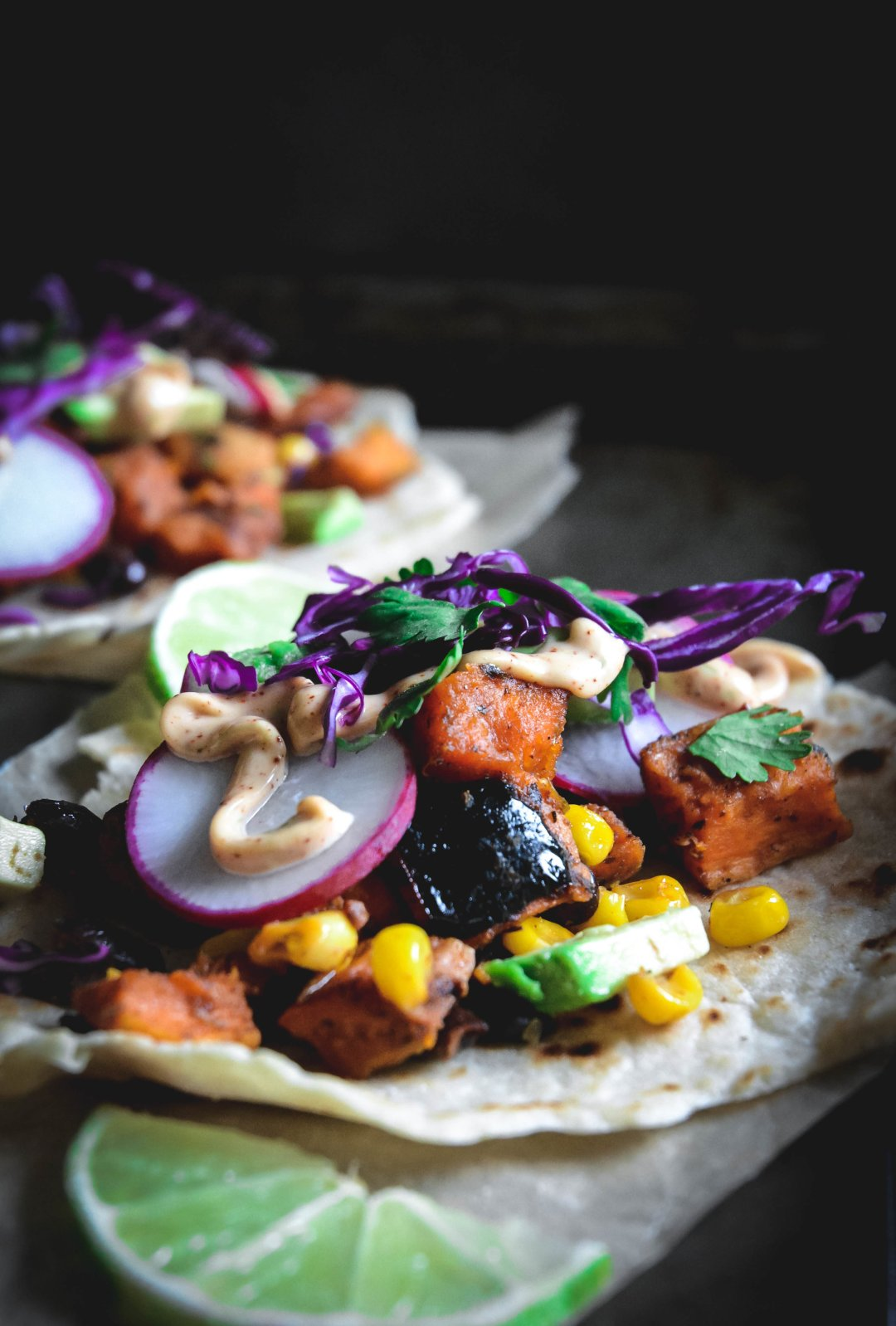 roasted vegetable tacos with radish, avocado, purple cabbage