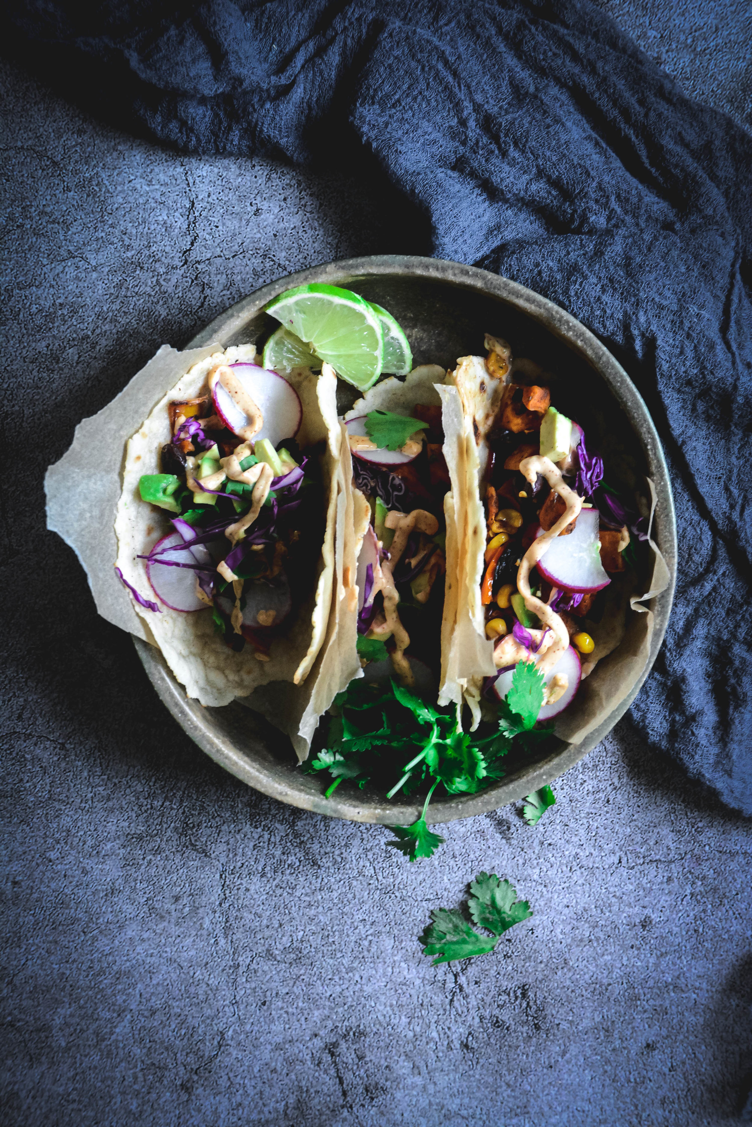 If you're looking for a delicious dinner you can whip up in 30 minutes, try these roasted vegetable vegan tacos. The great thing is they can be customized for whole 30 and paleo lifestyles, are completely vegan . #tacos #paleotacos #whole30tacos #vegantacos #vegan #vegetarian #roastedvegetables #calmeats #veganmexicanfood #dinner #healthyrecipes