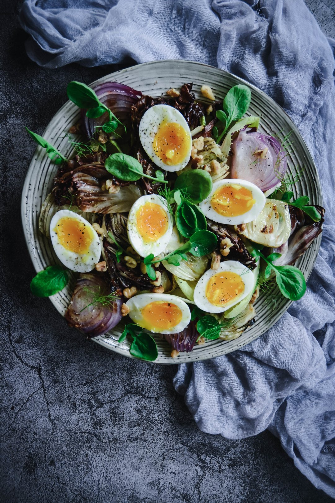 If you're looking for a delicious salad without the lettuce, check out this grilled radicchio and fennel salad with endives, soft boiled eggs, toasted walnuts and a tangy vinaigrette. It's simple yet delicious! #paleo #whole30 #vegetarian #calmeats #salad #radicchio #fennel #softboiledeggs #endive #whole30salad #paleosalad #saladrecipe #summerrecipe