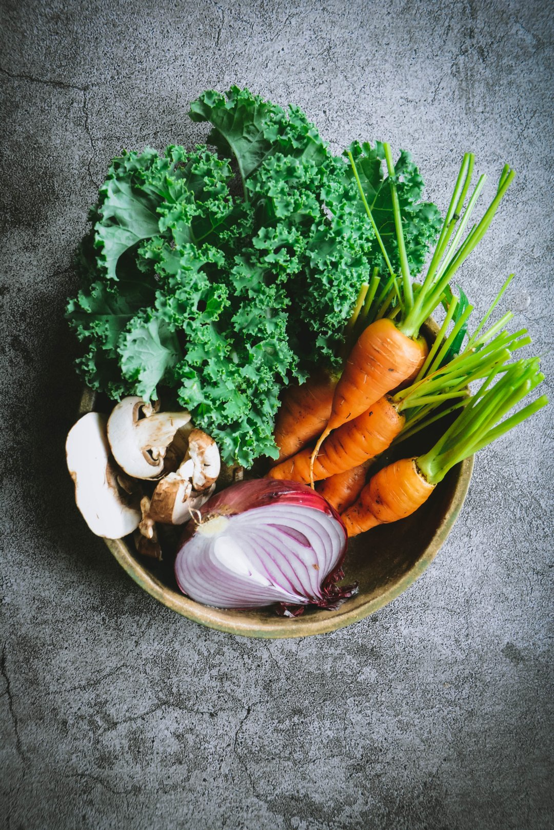 Kale mushrooms, carrots and mushrooms in bowl on table