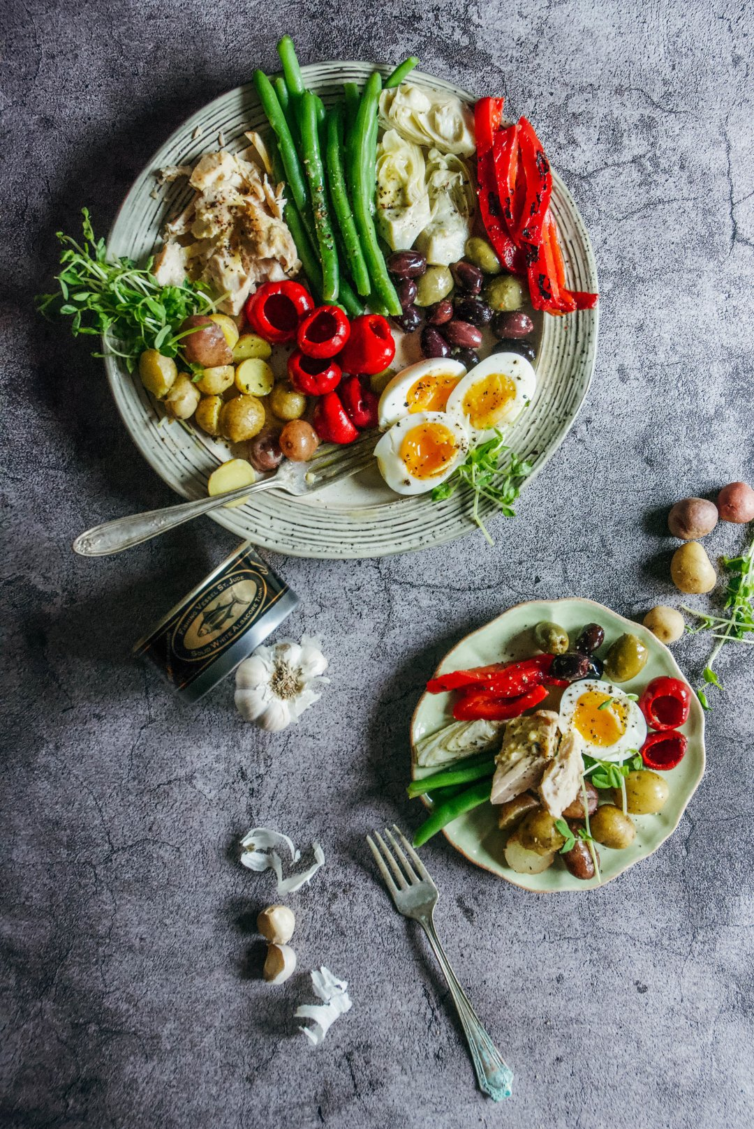 Salad Nicoise may just be the most perfect salad invented. Tasty St Jude Tuna works beautifully with, crunch green beans, creamy potatoes, soft boiled eggs, briny vegetables and tangy dressing. It's one recipe that's on repeat in my house. #saladnicoise #nicoisesalad #tunanicoisesalad #tunanicoise #calmeats #salad #pleosalad #whole30salad #whole30 #paleo #glutenfree #dairyfree #realfood #stjudetuna