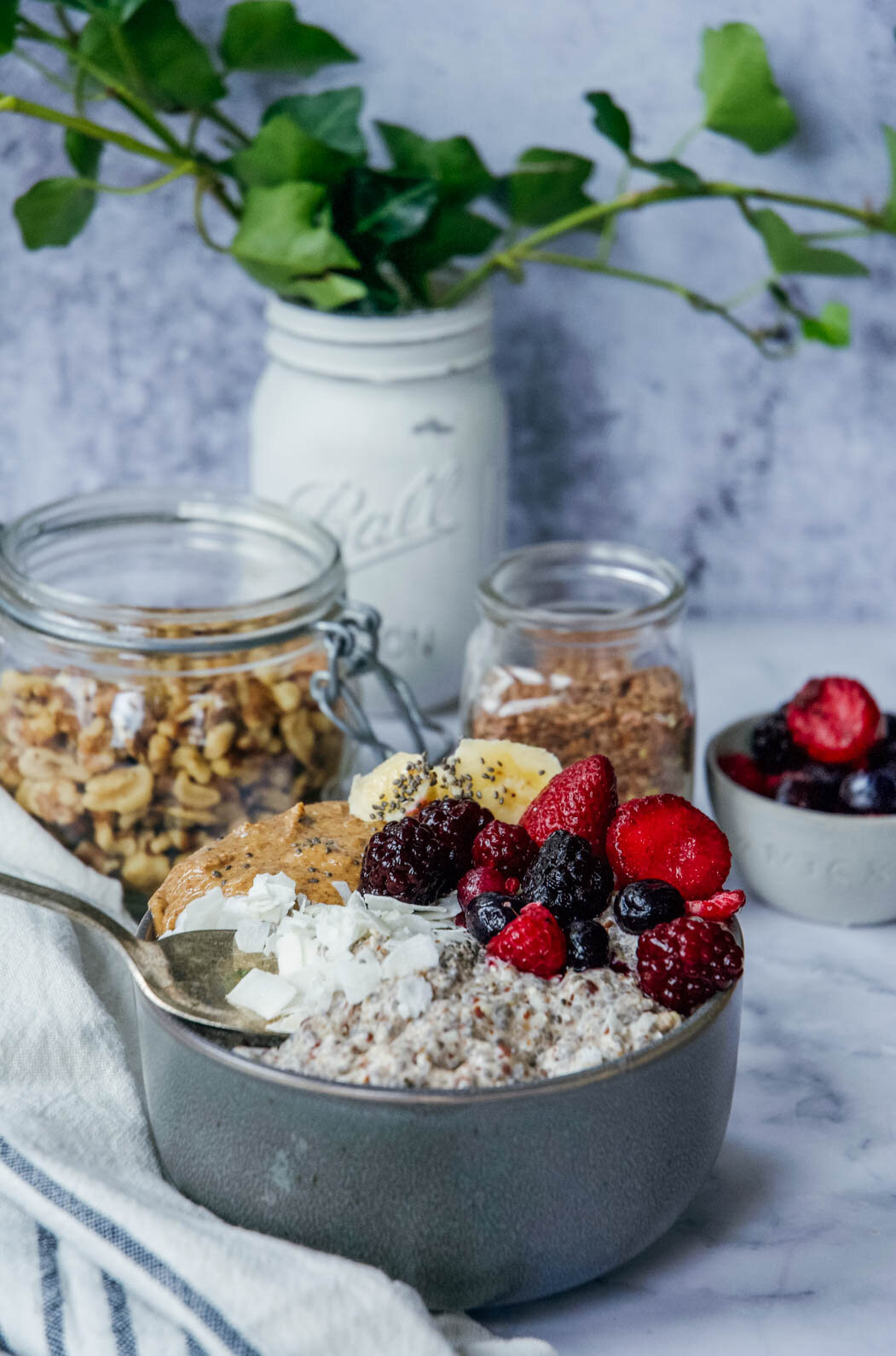 Overnight paleo oatmeal in bowl with nuts and seeds and fruits