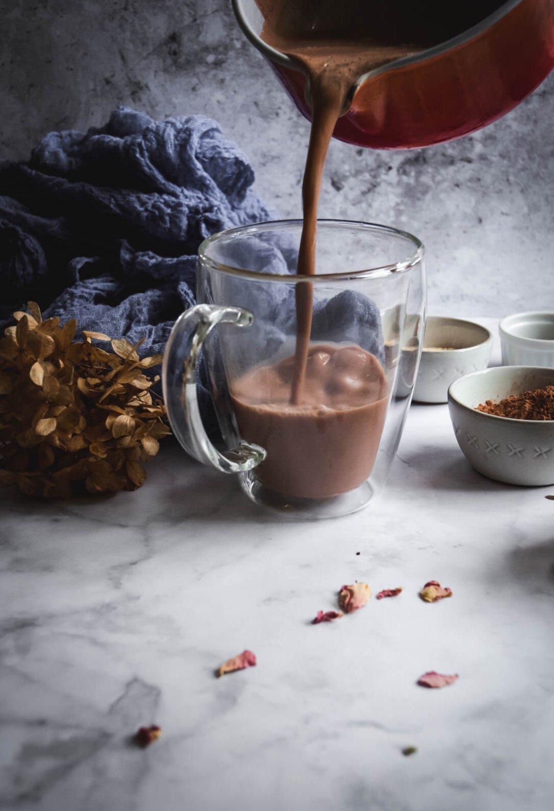 Hot chocolate poured into mug