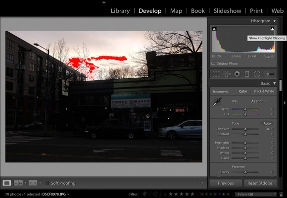 The clipped highlights are shown in red. You can have Lightroom point these areas out to you in the Histogram section of the Develop module.