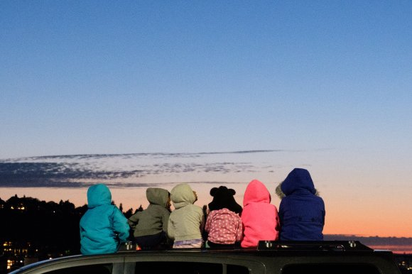 A group of children eagerly await the 4th of July fireworks in Seattle, Washington, 2017.