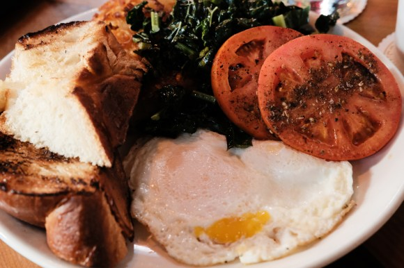 Corvus Breakfast. Eggs to order, toasted brioche, hash browns (they were perfect), sautéed greens, and roasted tomatoes. You can add bacon, too. Fujifilm X-H1 | ISO 10000 (not sure how I let that happen) | f/5.6 | 1/60th.