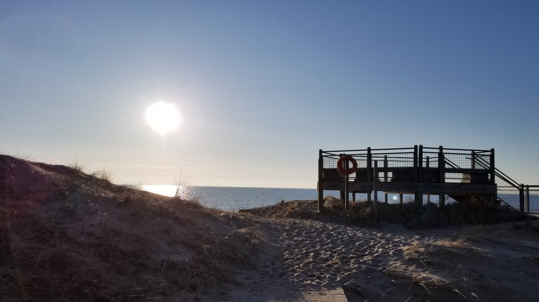 These sunset views are totally work the several story stair hike to the beachfront at Rosy Mound.