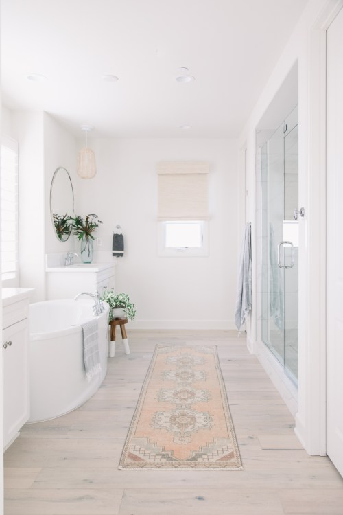 Beautiful light and airy bathroom design idea with Turkish vintage runner and glass shower surround - Pure Salt