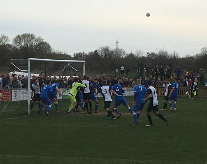 West attacking a corner at the clubhouse end.