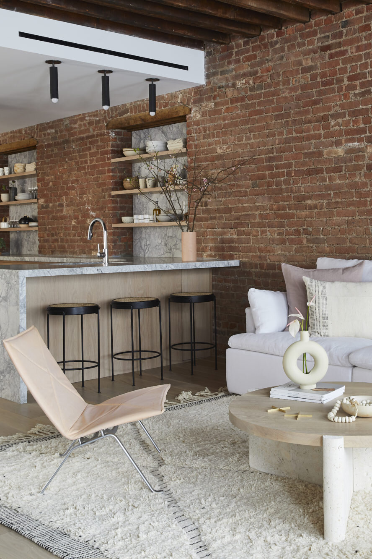 a soho loft with exposed brick and