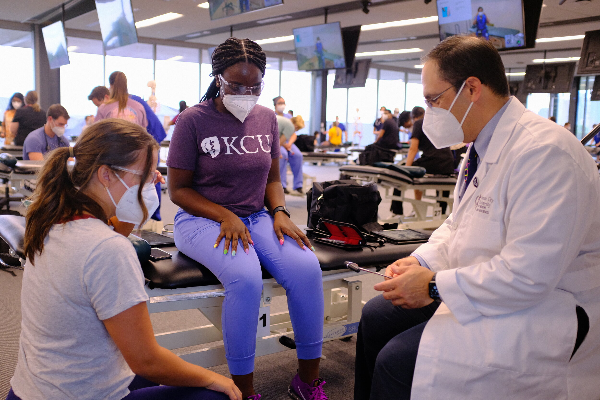 Darren D'Agostino, executive dean of Kansas City University, works with first-year medical students on the first day of classes July 29.  Courtesy of Kansas City University