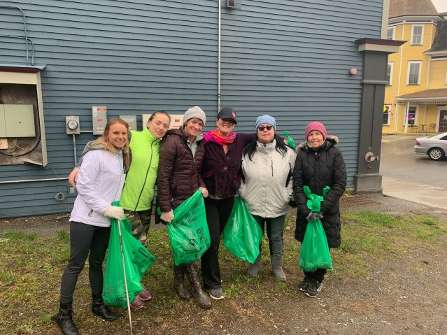 From left to right: Teen Challenge Members, Marina Kinney, Chelsea Bixby, Jessica Sheridan, Kelly Young, Megan Puryear and Deb Olsen pose as they take a break from picking up trash on Hardwick's Main Street. (Anna Kolosky/Community News Service)