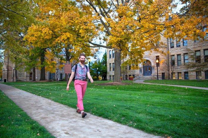 Dan Eggers walking to class at Baldwin Wallace University. Photo by Karin McKenna.