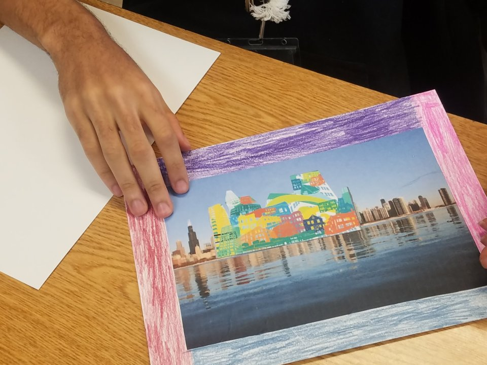 A Student floats Kyungmi Shin's mosaic on the lakefront.