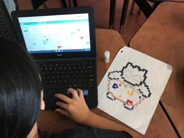 A Student using the free online software, SCRATCH.