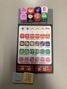 A Sushi Roll game board showing different sushi and their scores. Also showing multiple colorful dice up at the top, and two tile piles for swap and re-roll.