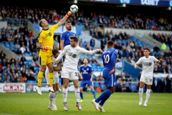 Burnley goalkeeper Joe Hart (left) punches the ball during the Premier League match at the Cardiff City Stadium.