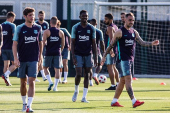 August 11, 2018 - Ousmane Dembele from France joking with Paco Alcacer from Spain during the FC Barcelona training session before the Spanish Supercopa game against Sevilla FC in…