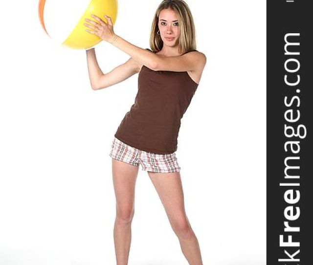 Fit And Slender Teen With Beach Ball