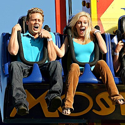 heidi and spencer on an amusing ride