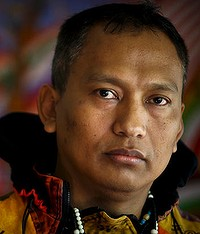 """Htoo Htoo Han, a Burmese refugee and an Australian resident of 15 years, poses for photos in Brisbane, Monday, July 18, 2011. Mr Han has admitted in taking part in war-crimes when he was working for the Junta in Burma, saying he personally executed at least 24 """"enemies"""" of the regime."""