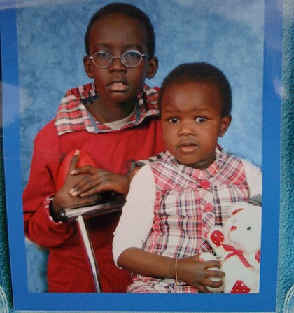 Mauled to death ... Ayen Chol, right, pictured with her older brother.