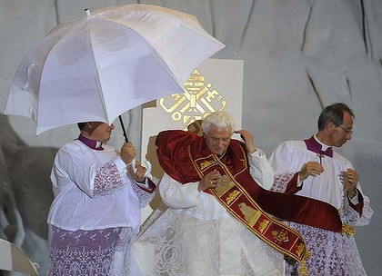 Wind blows as Pope Benedict XVI leads a prayer vigil.