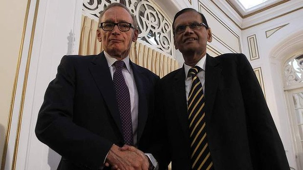 Australian Foreign Minister Bob Carr shakes hands with his Sri Lankan counterpart Gamini Lakshman Peiris during a joint media conference in Colombo in December, 2012.