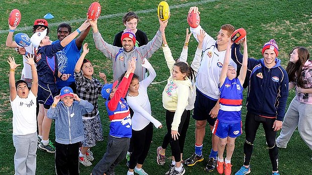 Bulldogs Brett Goodes, Liam Jones and Koby Stevens with Victorian indigenous kids from the Bulldogs Koori youth program at the Western Oval.