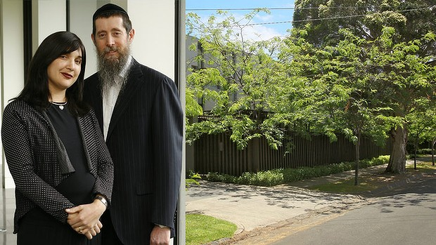 Nicole and Eliezer Kornhauser (left) at home and (right) the Springfield Avenue building at the heart of the conflict.