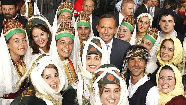 haw080214.001.003.jpg  Melbourne Lonsdale  street Greek Festival Prime Minister Tony Abbott with greek dancers Picture Wayne Hawkins