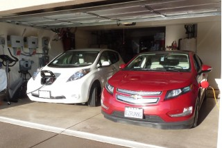 2011 Nissan Leaf and 2011 Chevy Volt, with charging station visible; photo by George Parrott