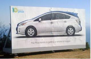 Prius MPV behind standard Prius