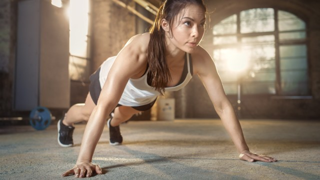 Young woman doing press-ups