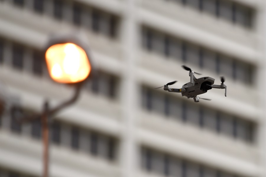 small drone over a city street