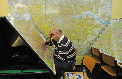 Man studying massive maps of London
