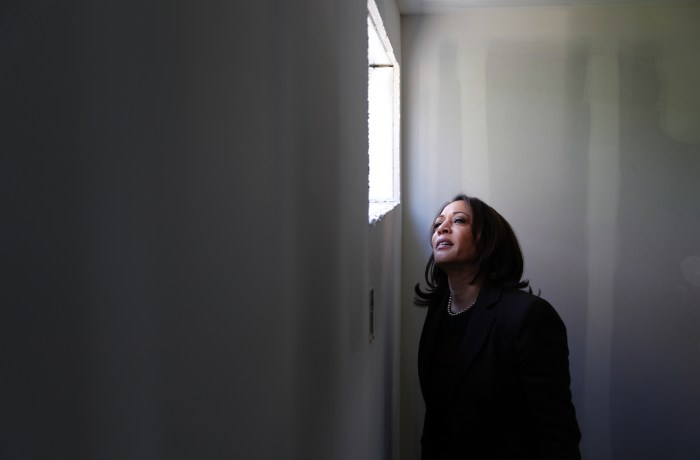 Senator Kamala Harris peers out of a window at Veterans Village in Las Vegas.