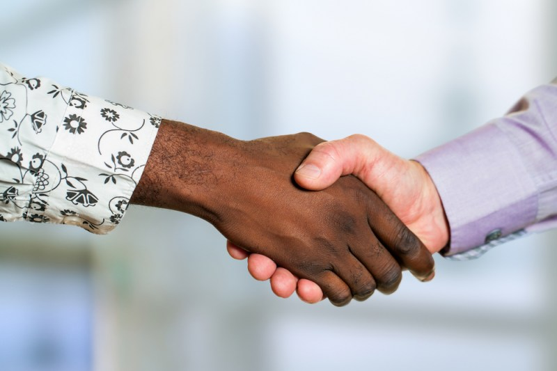 Black and white person shaking hands